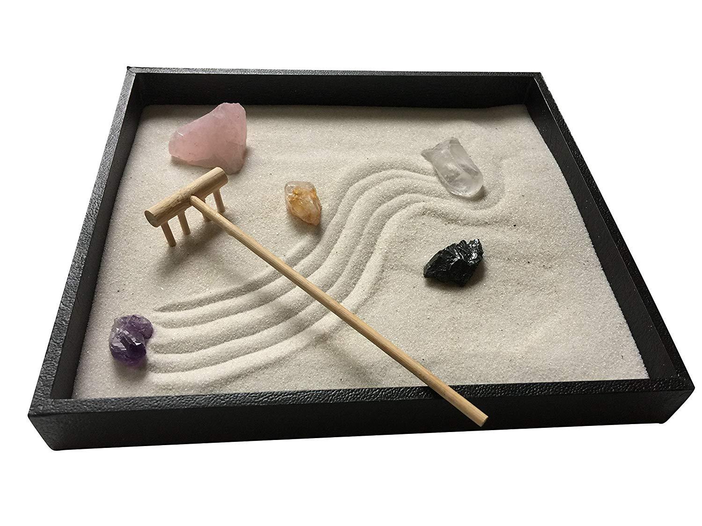 Zen Garden with White Sand and Bamboo Rake